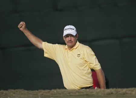 Bart Bryant celebrates hitting out of the bunker on the 18th green and making a birdie during the third round of THE TOUR Championship at East Lake Golf Club in Atlanta, Georgia on November 5, 2005. Bryant finished the third round in the lead at -14.Photo by Sam Greenwood/WireImage.com