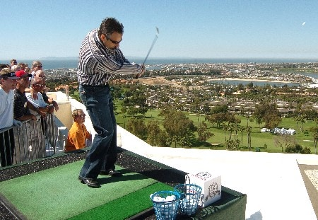 David Feherty follows through on his shot from the 16th floor of The Champions' Tour 2005 Toshiba Classic's 'Closet To The Pin' from the 16th floor at the Newport Beach Marriott Hotel in Newport Beach, California March 15, 2005.