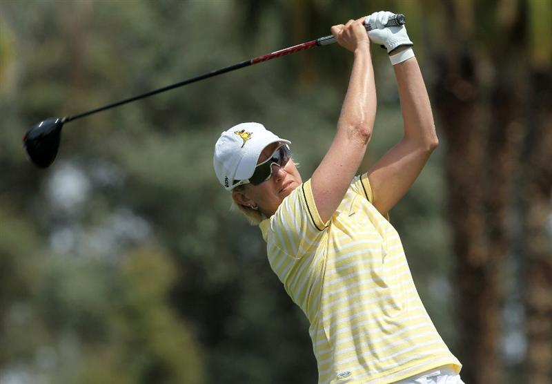RANCHO MIRAGE, CA - APRIL 03:  Karrie Webb of Australia hits her tee shot on  the third hole during the third round of the Kraft Nabisco Championship at Mission Hills Country Club on April 3, 2010 in Rancho Mirage, California.  (Photo by Stephen Dunn/Getty Images)