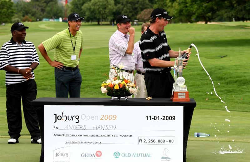 JOHANNESBURG, SOUTH AFRICA - JANUARY 11:  Anders Hansen of Denmark celebrates with champagne after his final round 66 to secure a one shot victory during the final round of the Joburg Open at Royal Johannesburg and Kensington Golf Club on January 11, 2009 in Johannesburg, South Africa.  (Photo by Richard Heathcote/Getty Images)