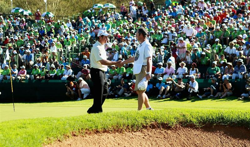 SUN CITY, SOUTH AFRICA - DECEMBER 05:  Lee Westwood of England celebrates with his caddie Billy Foster after winning the 2010 Nedbank Golf Challenge with a score of -17 at the Gary Player Country Club Course  on December 5, 2010 in Sun City, South Africa.  (Photo by Warren Little/Getty Images)