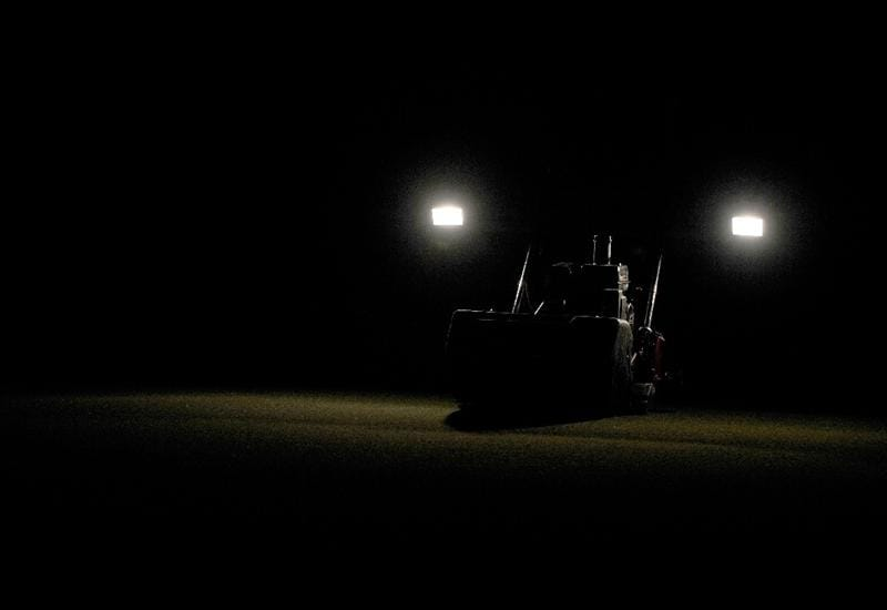 DORAL, FL - MARCH 10:  A mower lights up the green prior to a practice round for the World Golf Championships-CA Championship at the Doral Golf Resort & Spa on March 10, 2009 in Miami, Florida.  (Photo by Sam Greenwood/Getty Images)