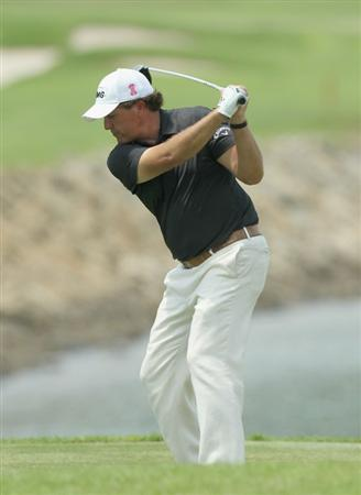 SINGAPORE - NOVEMBER 13: Phil Mickelson of USA tees off on the 7th hole during the Third Round of the Barclays Singapore Open held at the Sentosa Golf Club on November 13, 2010 in Singapore, Singapore.  (Photo by Stanley Chou/Getty Images)