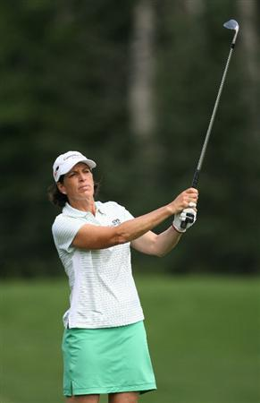 CALGARY, AB - SEPTEMBER 03: Juli Inkster of the United States watches her third shot on the ninth hole during the first round of the Canadian Women's Open at Priddis Greens Golf & Country Club on September 3, 2009 in Calgary, Alberta, Canada. (Photo by Hunter Martin/Getty Images)
