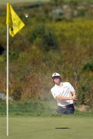 NORTON, MA - SEPTEMBER 06:  Brandt Snedeker hits a shot out of the bunker on the third hole during the final round of the Deutsche Bank Championship at TPC Boston on September 6, 2010 in Norton, Massachusetts.  (Photo by Mike Ehrmann/Getty Images)