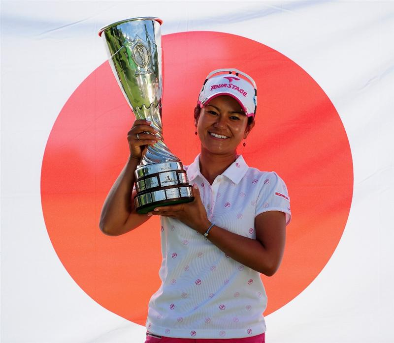 EVIAN-LES-BAINS, FRANCE - JULY 26: Ai Miyazato of Japan poses with the winners trophy after winning in a playoff against Sofie Gustafson of Sweden during the final round of the Evian Masters at the Evian Masters Golf Club on July 26, 2009 in Evian-les-Bains, France.  (Photo by Stuart Franklin/Getty Images)