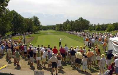 Fans watch Nathan Green start his play on the first tee during the third round of the U.S. Bank Championship in Milwaukee at Brown Deer Park Golf Course in Milwaukee, Wisconsin, on July 29, 2006.Photo by Steve Levin/WireImage.com