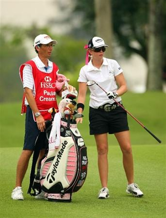 SINGAPORE - MARCH 07:  Paula Creamer of the USA waits with her caddie on the ninth hole during the third round of the HSBC Women's Champions at Tanah Merah Country Club on March 7, 2009 in Singapore.  (Photo by Andrew Redington/Getty Images)