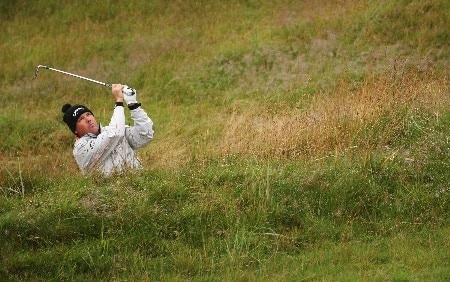 CARNOUSTIE, UNITED KINGDOM - JULY 19:  Rich Beem of USA hits a shot from a bunker on the second hole during the first round of The 136th Open Championship at the Carnoustie Golf Club on July 19, 2007 in Carnoustie, Scotland.  (Photo by Ross Kinnaird/Getty Images)