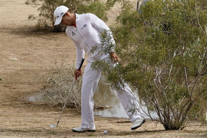 SCOTTSDALE, AZ - FEBRUARY 28:  Camilo Villegas of Columbia tries to figure out how to play his ball out of the rough on the 12th hole during the final round of the Waste Management Phoenix Open at TPC Scottsdale on February 28, 2010 in Scottsdale, Arizona.  (Photo by Chris McGrath/Getty Images)