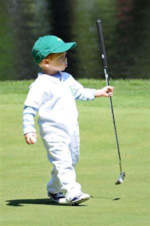 AUGUSTA, GA - APRIL 08:  Jacob Immelman walks across the ninth green while caddying for his father Trevor Immelman during the Par 3 Contest prior to the 2009 Masters Tournament at Augusta National Golf Club on April 8, 2009 in Augusta, Georgia.  (Photo by Harry How/Getty Images)