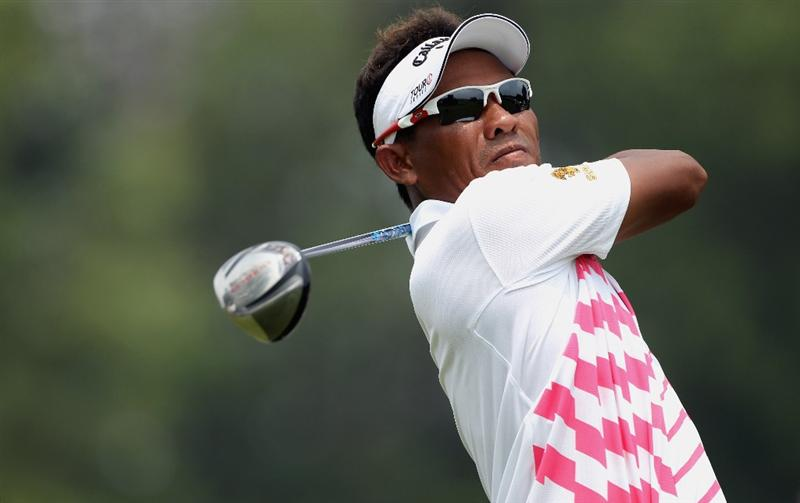 KUALA LUMPUR, MALAYSIA - MARCH 07:  Thongchai Jaidee of Thailand hits his tee-shot on the seventh hole during the the final round of the Maybank Malaysian Open at the Kuala Lumpur Golf and Country Club on March 7, 2010 in Kuala Lumpur, Malaysia.  (Photo by Andrew Redington/Getty Images)
