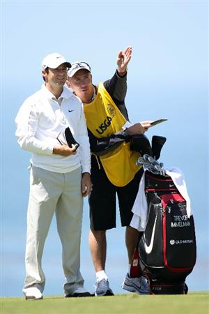 PEBBLE BEACH, CA - JUNE 17:  (L-R) Trevor Immelman of South Africa talks with caddie Mick Doran on the 11th fairway during the first round of the 110th U.S. Open at Pebble Beach Golf Links on June 17, 2010 in Pebble Beach, California.  (Photo by Ross Kinnaird/Getty Images)
