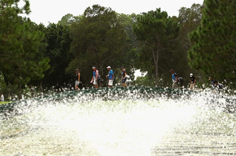 GOLD COAST, AUSTRALIA - MARCH 05:  A general view of golfers walking across the bridge on the 7th hole during round two of the 2010 ANZ Ladies Masters at Royal Pines Resort on March 5, 2010 in Gold Coast, Australia.  (Photo by Ryan Pierse/Getty Images)