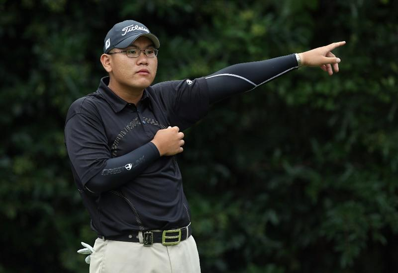KAWAGOE CITY, JAPAN - OCTOBER 08:  Tze Huang Choo of Singapore reacts to his partners shot on the 8th hole during the second round of the 2010 Asian Amateur Championship at Kasumigaseki Country Club on October 8, 2010 in Kawagoe City, Japan.  (Photo by Streeter Lecka/Getty Images)