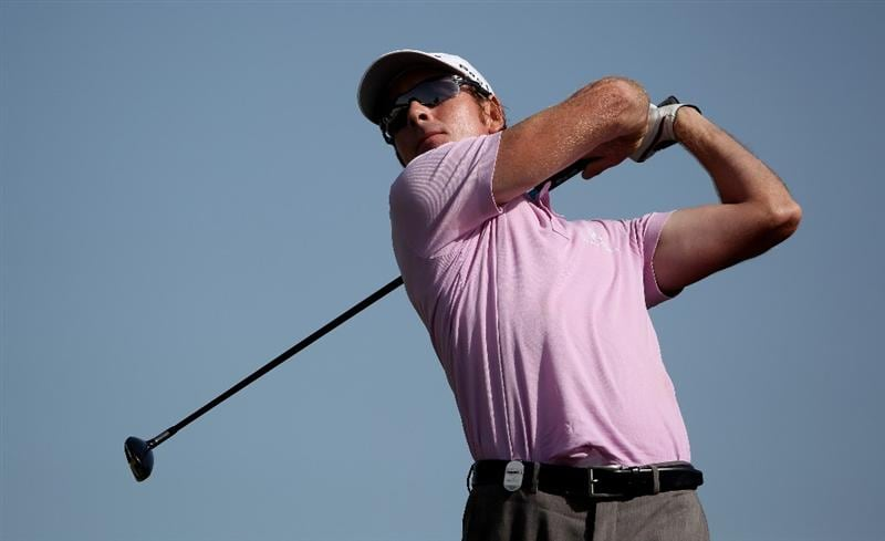 DOHA, QATAR - JANUARY 30:  Brett Rumford of Australia hits his tee-shot on the seventh hole during the third round of the Commercialbank Qatar Masters at Doha Golf Club on January 30, 2010 in Doha, Qatar.  (Photo by Andrew Redington/Getty Images)