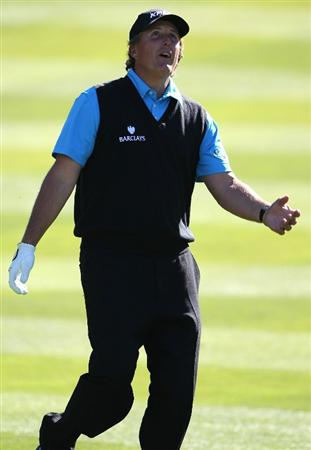PEBBLE BEACH, CA - FEBRUARY 11:  Phil Mickelson reacts after hitting on the first hole at the AT&T Pebble Beach National Pro-Am- Round Two at the Spyglass golf club on February 11, 2011 in Pebble Beach, California.  (Photo by Jed Jacobsohn/Getty Images)