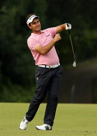 SOTOGRANDE, SPAIN - OCTOBER 29:  Edoardo Molinari of Italy lets go of his club as he plays into the 5th green during the second round of the Andalucia Valderrama Masters at Club de Golf Valderrama on October 29, 2010 in Sotogrande, Spain.  (Photo by Richard Heathcote/Getty Images)