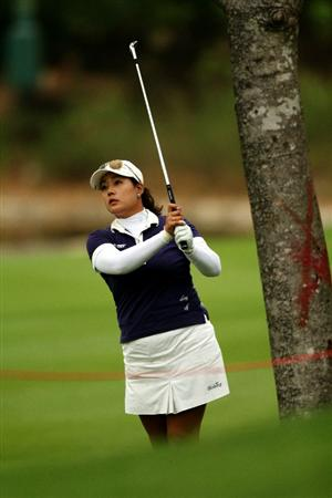 KUALA LUMPUR, MALAYSIA - OCTOBER 22:   Jee Young Lee of Korea Republic plays her 2nd shot on the 8th hole during Round One of the Sime Darby LPGA on October 22, 2010 at the Kuala Lumpur Golf and Country Club in Kuala Lumpur, Malaysia. (Photo by Stanley Chou/Getty Images)