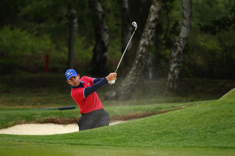 VIRGINIA WATER, ENGLAND - MAY 26:  Ignacio Garrido of Spain plays from the bunker on the nineth during the first round of the BMW PGA Championship at Wentworth Club on May 26, 2011 in Virginia Water, England.  (Photo by Richard Heathcote/Getty Images)