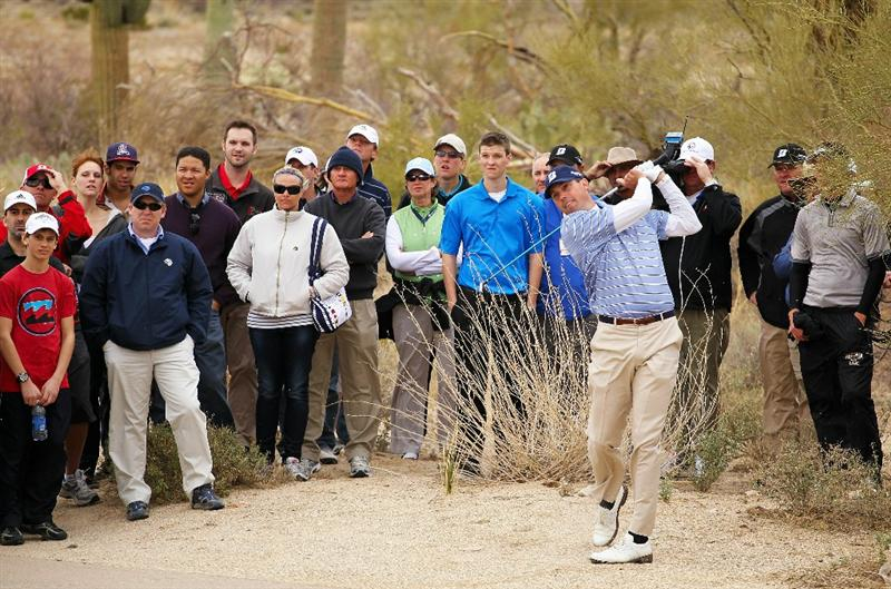 MARANA, AZ - FEBRUARY 26:  Matt Kuchar hits an approach shot on the rough on the seventh hole in front of a gallery of fans during the semifinal round of the Accenture Match Play Championship at the Ritz-Carlton Golf Club on February 26, 2011 in Marana, Arizona.  (Photo by Andy Lyons/Getty Images)