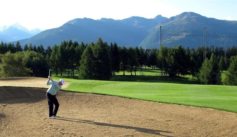 CRANS, SWITZERLAND - SEPTEMBER 05:  Bertt Romford of Australia plays hius second shot on the par four 12th hole during the second round the Omega European Masters at the Golf Club Crans-sur-Sierre on September 5, 2008 in Crans, Switzerland.  (Photo by Ross Kinnaird/Getty Images)