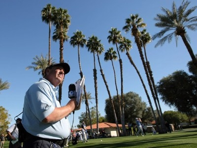 Mike Ritz of The golf Channel watches the tee shot of D.J. Trahan during the third round of the 49th Bob Hope Chrysler Classic at the La Quinta Country Club on January 18, 2008 in La Quinta, California. PGA TOUR - 2008 Bob Hope Chrysler Classic - Round ThreePhoto by Harry How/Getty Images