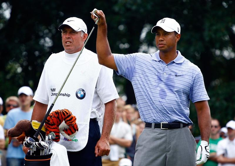 LEMONT, IL - SEPTEMBER 12:  Tiger Woods pulls a club on the second tee as his caddie Steve Williams looks on during the third round of the BMW Championship held at Cog Hill Golf & CC on September 12, 2009 in Lemont, Illinois.  (Photo by Scott Halleran/Getty Images)