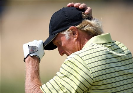 TROON, UNITED KINGDOM - JULY 24:  Greg Norman of Australia adjusts his hat during the first round of the Senior Open Championships at Royal Troon on July 24, 2008 in Troon, Scotland.  (Photo by Ross Kinnaird/Getty Images)
