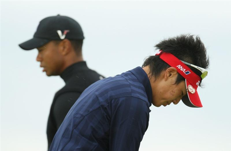 TURNBERRY, SCOTLAND - JULY 17:  Ryo Ishikawa of Japan and Tiger Woods of USA look on during round two of the 138th Open Championship on the Ailsa Course, Turnberry Golf Club on July 17, 2009 in Turnberry, Scotland.  (Photo by Ross Kinnaird/Getty Images)
