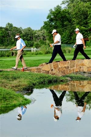 CHASKA, MN - AUGUST 13:  David Toms, Paul Azinger and Phil Mickelson crosse a bridge on the 16th hole during the first round of the 91st PGA Championship at Hazeltine National Golf Club on August 13, 2009 in Chaska, Minnesota.  (Photo by Stuart Franklin/Getty Images)