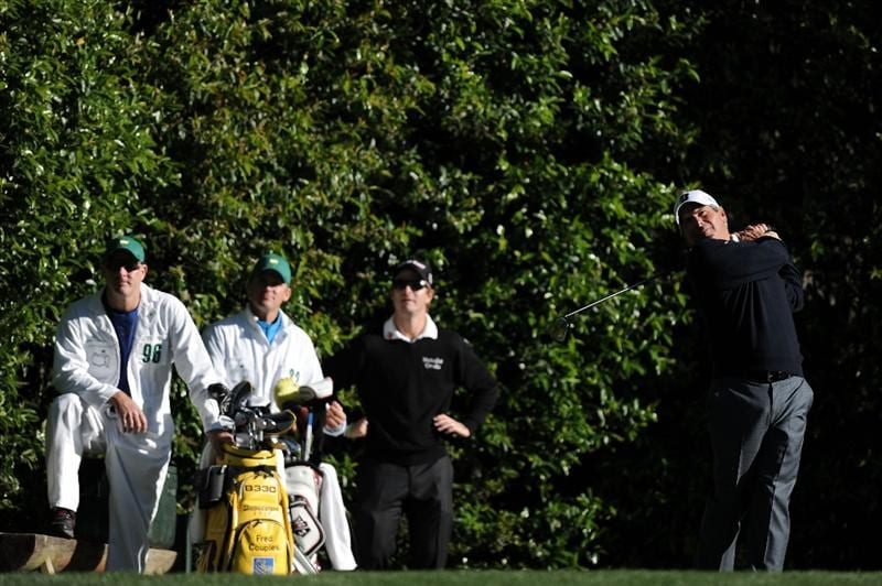 AUGUSTA, GA - APRIL 06:  Fred Couples hits a shot as Kevin Streelman looks on during a practice round prior to the 2011 Masters Tournament at Augusta National Golf Club on April 6, 2011 in Augusta, Georgia.  (Photo by Harry How/Getty Images)