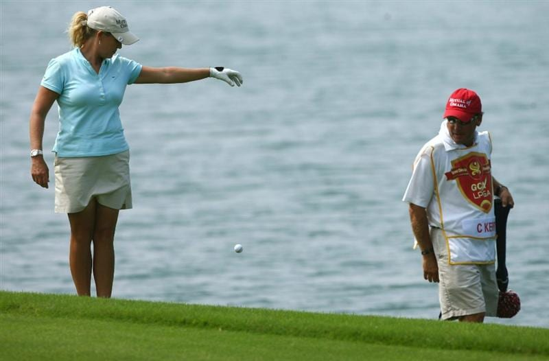 HAIKOU, CHINA - OCTOBER 24: (CHINA OUT) Cristie Kerr (L) of the US takes a drop on the 9th hole during day one of the Grand China Air LPGA 2008 on October 24, 2008 in Haikou of Hainan Province, China. (Photo by China Photos/Getty Images)