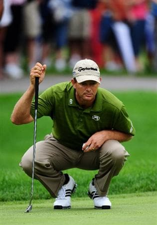 AKRON, OH - AUGUST 08:  Retief Goosen of South Africa lines up his putt on the first hole during the third round of the World Golf Championship Bridgestone Invitational on August 8, 2009 at Firestone Country Club in Akron, Ohio.  (Photo by Stuart Franklin/Getty Images)