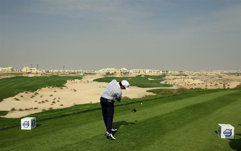BAHRAIN, BAHRAIN - JANUARY 27:  Matteo Manassero of Italy plays his tee shot at the 3rd hole during the first round of the 2011 Volvo Champions held at the Royal Golf Club on January 27, 2011 in Bahrain, Bahrain.  (Photo by David Cannon/Getty Images)