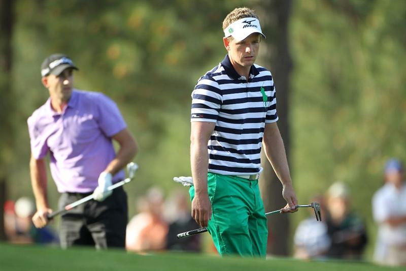 AUGUSTA, GA - APRIL 08:  Geoff Ogilvy of Australia (L) and Luke Donald of England line up putts on the first green during the first round of the 2010 Masters Tournament at Augusta National Golf Club on April 8, 2010 in Augusta, Georgia.  (Photo by Jamie Squire/Getty Images)