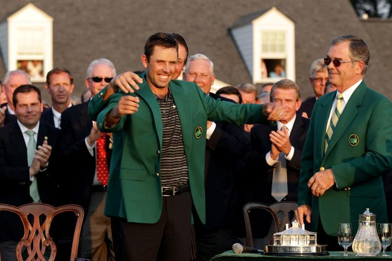 AUGUSTA, GA - APRIL 10:  Phil Mickelson (C) presents Charl Schwartzel of South Africa (L) the winner's jacket at the green jacket presentation as William Porter Payne looks on after Schwartzel's two-stroke victory at the 2011 Masters Tournament at Augusta National Golf Club on April 10, 2011 in Augusta, Georgia.  (Photo by David Cannon/Getty Images)
