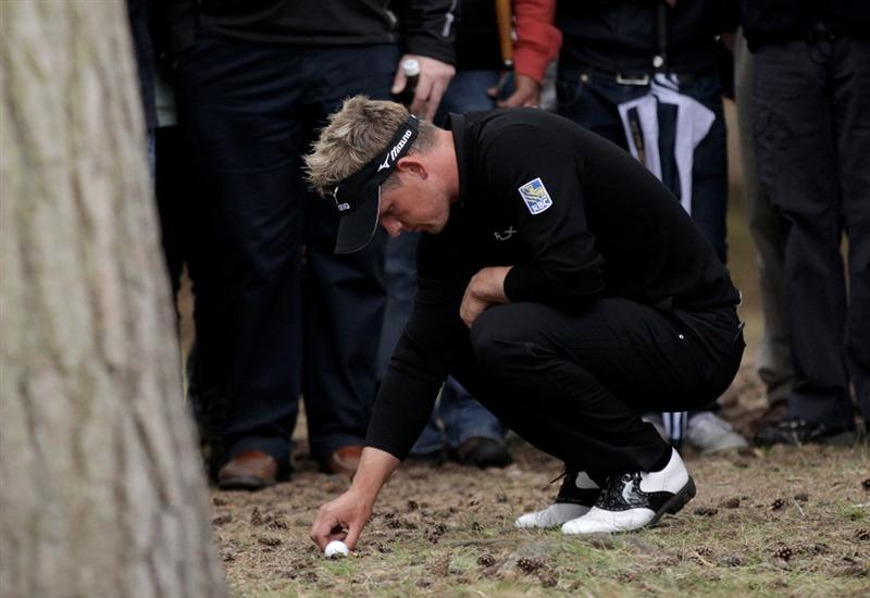 VIRGINIA WATER, ENGLAND - MAY 28:  Luke Donald of England checks his lie on the 13th hole during the third round of the BMW PGA Championship at the Wentworth Club on May 28, 2011 in Virginia Water, England.  (Photo by David Cannon/Getty Images)