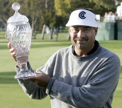 2006 winner of the Toshiba Classic Brad Bryant holds the trophy after winning with a birdie on the 18th hole on March 19, 2006, at Newport Beach Country Club, Newport Beach, California.Photo by Gregory Shamus/WireImage.com