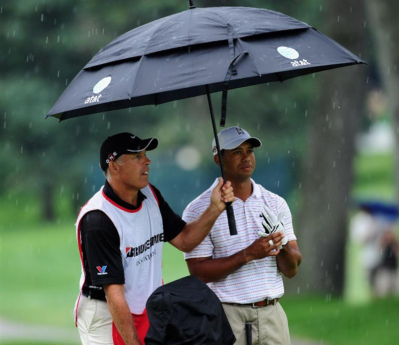 AKRON, OH - AUGUST 08:  Tiger Woods of USA and caddie Steve Williams on the second hole during the third round of the World Golf Championship Bridgestone Invitational on August 8, 2009 at Firestone Country Club in Akron, Ohio.  (Photo by Stuart Franklin/Getty Images)