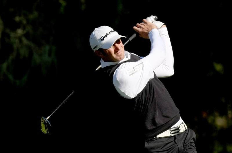 PEBBLE BEACH, CA - FEBRUARY 13: Dustin Johnson hits his tee shot on the eighth hole at Spyglass Hill Golf Course during the second round of the the AT&T Pebble Beach National Pro-Am on February 13, 2009 in Pebble Beach, California. (Photo by Stephen Dunn/Getty Images)