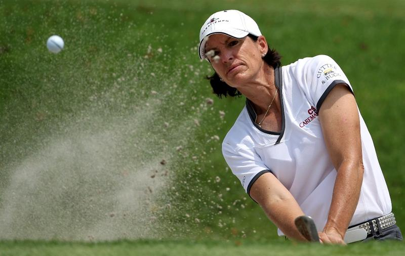 SINGAPORE - FEBRUARY 26:  Juli Inkster of the USA plays a bunker shot on the 17th hole during the second round of the HSBC Women's Champions at the Tanah Merah Country Club on February 26, 2010 in Singapore.  (Photo by Andrew Redington/Getty Images)