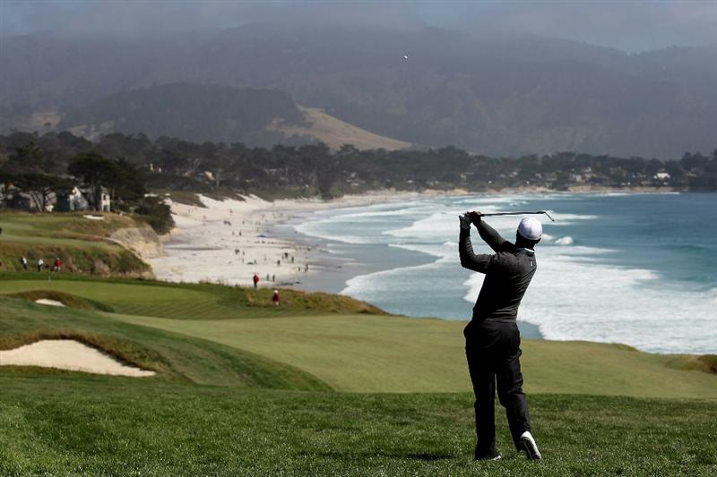 PEBBLE BEACH, CA - JUNE 17:  Tiger Woods hits his second shot on the ninth hole during the first round of the 110th U.S. Open at Pebble Beach Golf Links on June 17, 2010 in Pebble Beach, California.  (Photo by Ross Kinnaird/Getty Images)