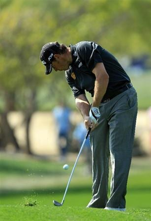 DUBAI, UNITED ARAB EMIRATES - FEBRUARY 12:  Lee Westwood of England plays his second shot at the 1st hole during the third round of the 2011 Omega Dubai Desert Classic on the Majilis Course at the Emirates Golf Club on February 12, 2011 in Dubai, United Arab Emirates.  (Photo by David Cannon/Getty Images)