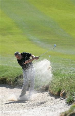 PARKER, CO - MAY 27:   Sam Torrance hits out of the greenside bunker on the 9th hole during the first round of the Senior PGA Championship at the Colorado Golf Club  on May 27, 2010 in Parker, Colorado.  (Photo by Marc Feldman/Getty Images)