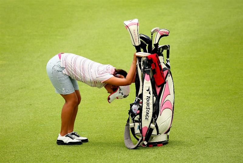 SINGAPORE - MARCH 07:  Ai Miyazato of Japan stretches on the ninth hole during the third round of the HSBC Women's Champions at Tanah Merah Country Club on March 7, 2009 in Singapore.  (Photo by Andrew Redington/Getty Images)