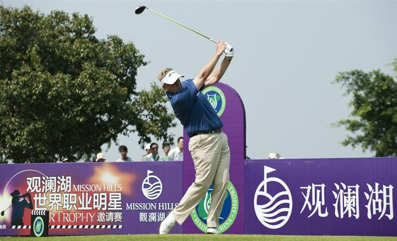 HAIKOU, CHINA - OCTOBER 30:  Colin Montgomerie of Scotland tees off on the 6th hole during day four of the Mission Hills Start Trophy tournament at Mission Hills Resort on October 30, 2010 in Haikou, China. The Mission Hills Star Trophy is Asia's leading leisure liflestyle event and features Hollywood celebrities and international golf stars.  (Photo by Victor Fraile/Getty Images for Mission Hills)
