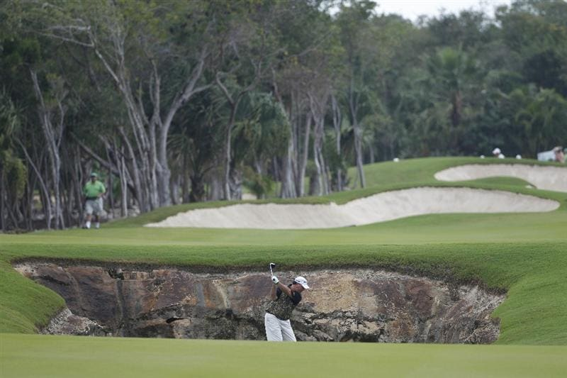 PLAYA DEL CARMEN, MEXICO - FEBRUARY 26:  Boo Weekley hits his second shot on the first hole from near a cenote during the third round of the Mayakoba Golf Classic at Riviera Maya-Cancun held at El Camaleon Golf Club on February 26, 2011 in Playa del Carmen, Mexico.  (Photo by Michael Cohen/Getty Images)