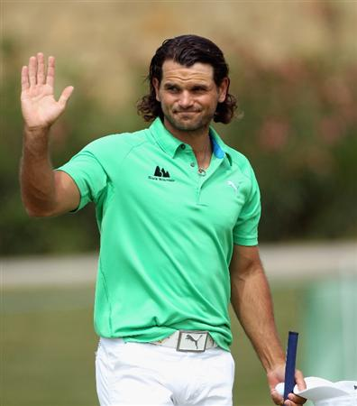 CASARES, SPAIN - MAY 20:  Johan Edfors of Sweden waves to the crowd after winning his match during the group stages of the Volvo World Match Play Championship at Finca Cortesin on May 20, 2011 in Casares, Spain.  (Photo by Andrew Redington/Getty Images)