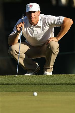 CHARLOTTE, NC - APRIL 30:  Ricky Barnes lines up a putt on the 15th green during the second round of the Quail Hollow Championship at Quail Hollow Country Club on April 30, 2010 in Charlotte, North Carolina.  (Photo by Streeter Lecka/Getty Images)